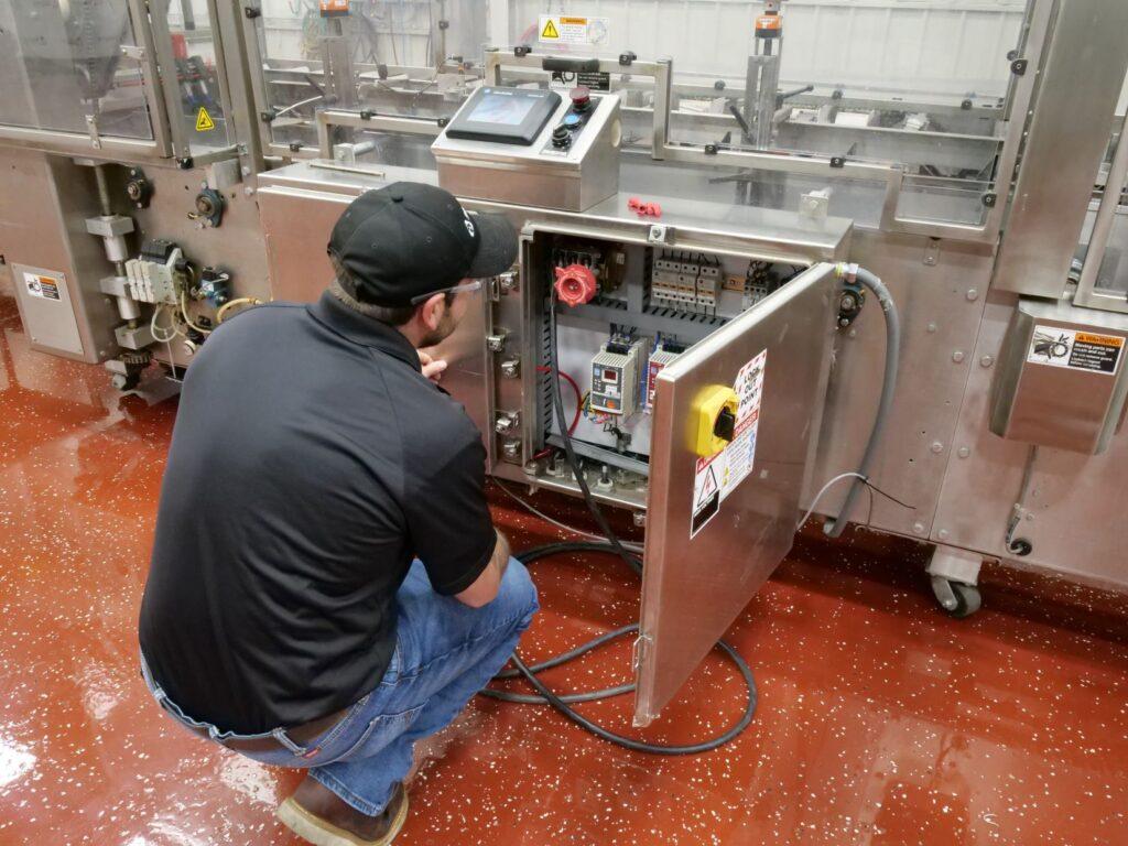 SIGMA-Recovery-Employee-Repairing Equipment