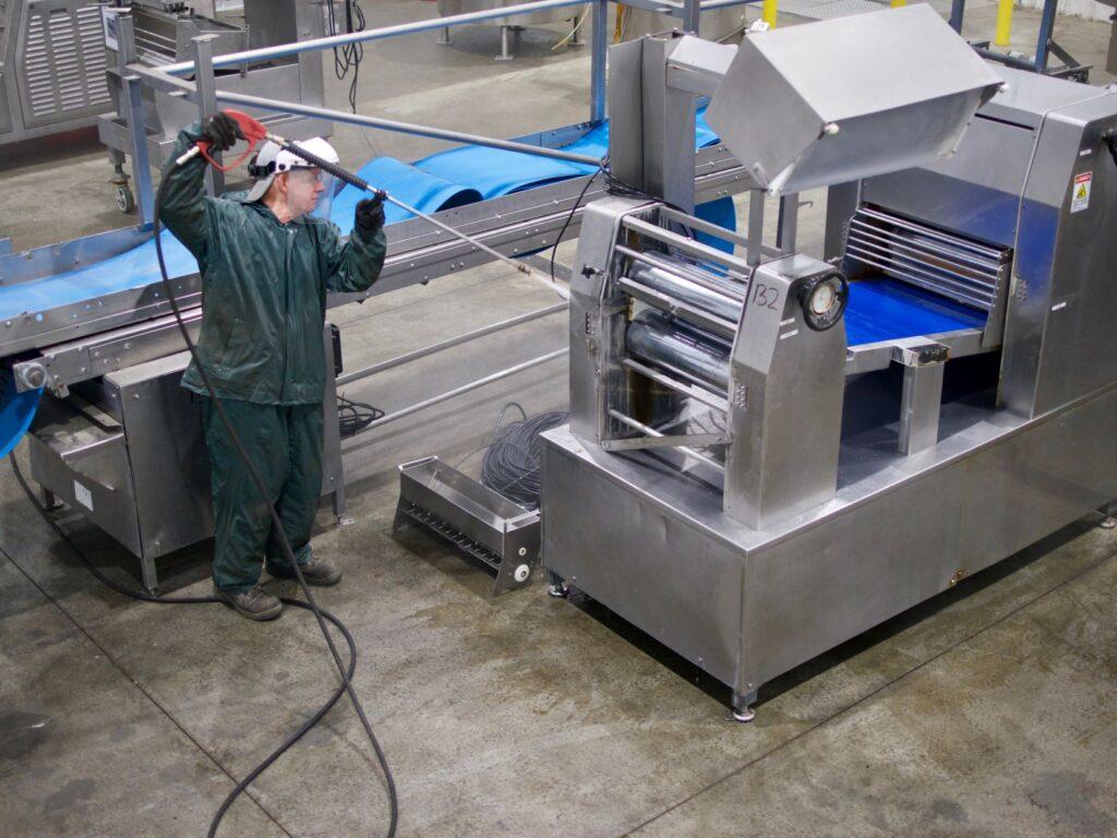 SIGMA-Recovery-Employee-Powerwashing-Equipment-in-Storage